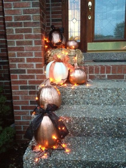 1-24-painted-pumpkins-outside-displayed-with-lights