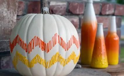 1-candy-corn-chevron-pumpkin-30-pumpkin-decorating-ideas-via-fox-hollow-cottage