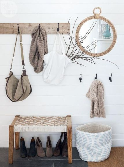 10-a-wooden-rack-a-rope-mirror-a-basket-for-storage-a-woven-bench-for-a-serene-boho-look