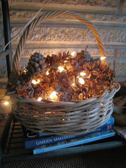 10-put-pinecones-in-a-basket-and-gently-wrap-white-christmas-lights-throughout