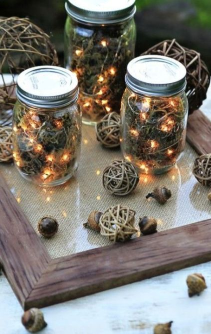 11-use-dried-moss-acorns-and-string-lights-to-craft-these-rustic-lanterns-1