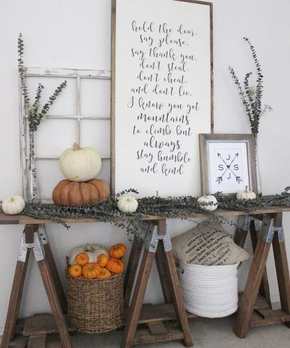 19-a-farmhouse-trestle-table-with-dried-eucalyptus-white-and-orange-pumpkins-signs-and-baskets