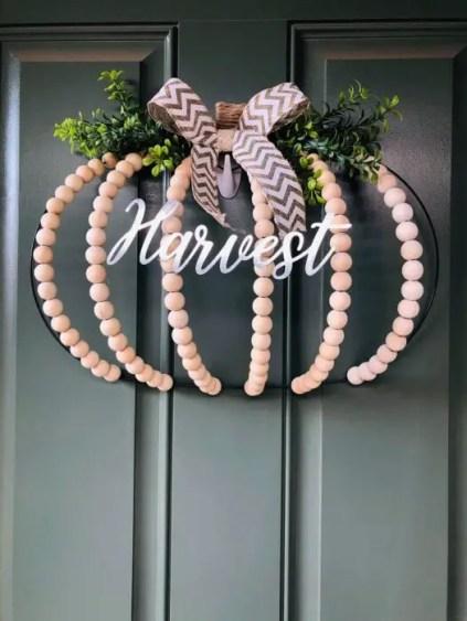 2.2-dollar-tree-pumpkin-wire-wreath-using-wood-beads-525x700-1
