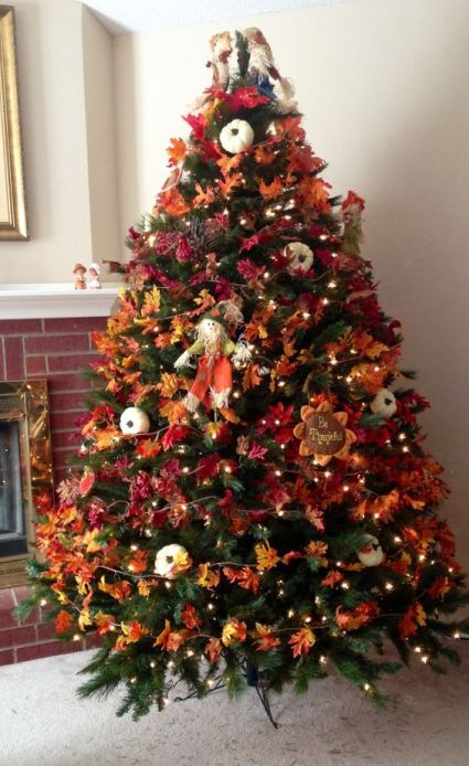 21-a-bold-vintage-inspired-thanksgiving-tree-with-lights-bright-leaves-pumpkins-faux-blooms-and-a-scarecrow