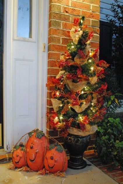 24-a-simple-fall-or-thanksgiving-tree-decorated-with-faux-leaves-burlap-ribbons-and-lights-is-a-stylish-outdoor-decoration