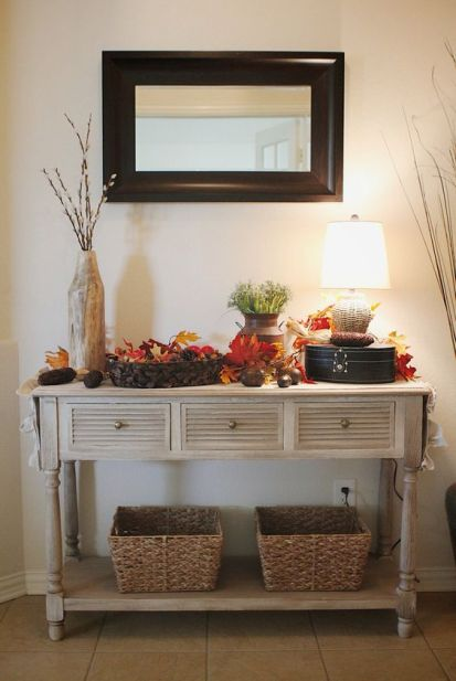 25-a-vintage-rustic-console-table-with-baskets-fall-leaves-pinecones-corn-cobs-and-greenery-in-a-vase