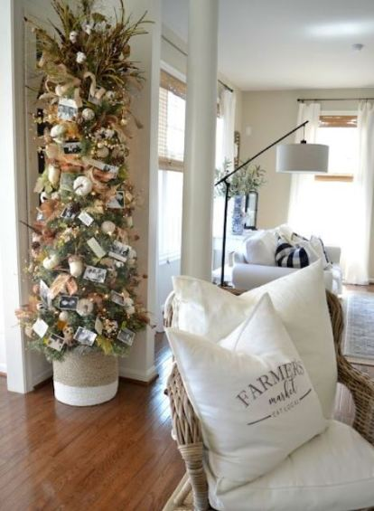 A-thanksgiving-tree-with-white-pumpkins-acorns-leaves-lights-pinecones-grasses-and-family-pics-is-very-cute