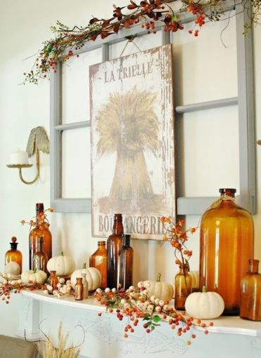 A-bright-fall-mantel-with-a-vintage-sign-faux-berries-and-branches-white-pumpkins-and-amber-colored-bottles