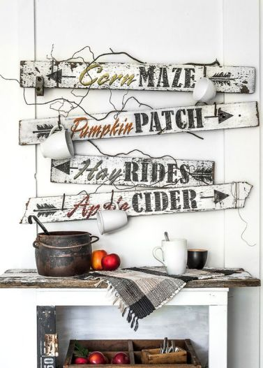 A-bunch-of-white-and-black-fall-signs-with-mugs-hanging-on-them-look-very-relaxed-and-farmhouse-like