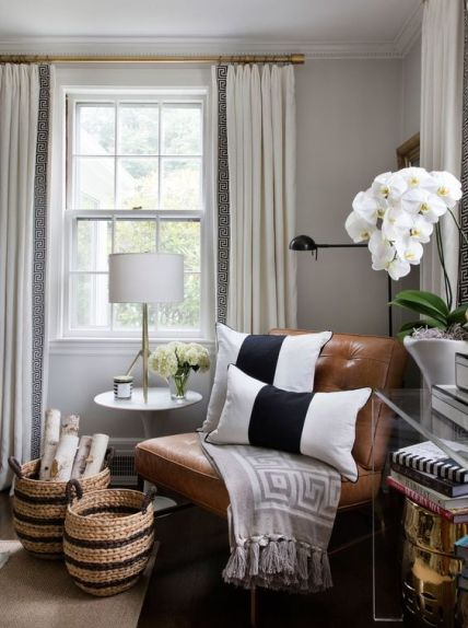 A-cute-nook-with-a-leather-chair-some-orchids-and-matching-striped-baskets-for-storage