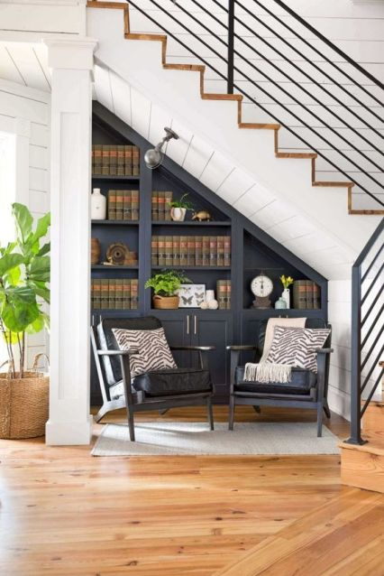 A-dark-built-in-bookcase-and-a-couple-of-dark-chairs-to-form-a-reading-nook-easily-and-without-taking-much-space