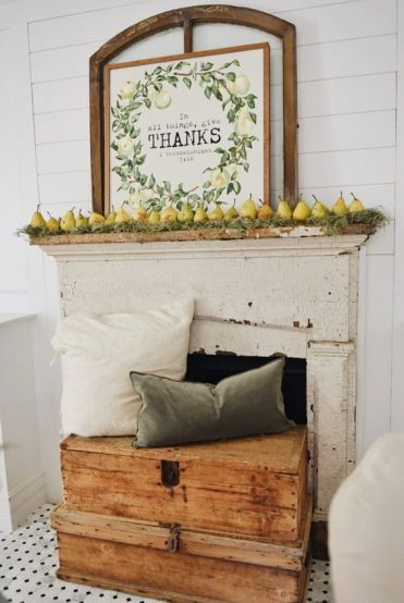 A-harvest-fall-mantel-with-moss-pears-and-a-cool-sign-plus-muted-pillows-on-wooden-boxes