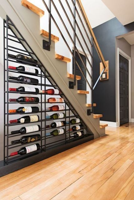 A-large-metal-wine-shelf-under-the-stairs-is-a-cool-idea-to-rock-in-any-living-room-your-little-wine-nook-is-here