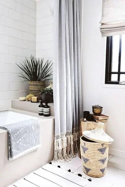 A-mid-century-modern-boho-bathroom-with-a-basket-with-a-lid-for-storage-so-cool-and-so-boho-like