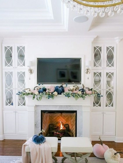 A-pastel-fall-mantel-with-blush-and-navy-velvet-pumpkins-and-fresh-greenery-is-a-cool-modern-idea-2