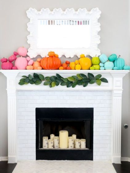 A-super-colorful-fall-mantel-with-super-bright-pumpkins-and-birch-inspried-candles-in-the-fireplace-1