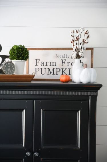An-elegant-framed-monochromatic-sign-in-a-staiend-wooden-frame-some-cotton-and-fake-pumpkins