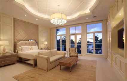Contemporary-tan-bedroom-with-decorative-tray-ceiling-and-outdoor-balcony