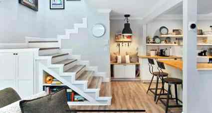 Custom-storage-space-under-stairs-with-shelves-and-cabinet