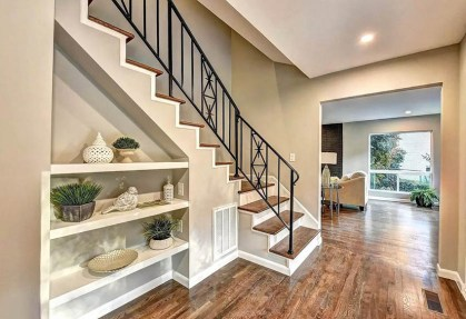 Under-stairs-niche-with-shelving-for-home-decor
