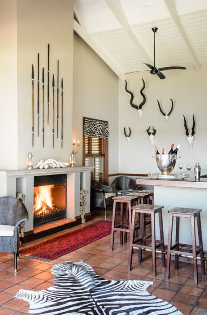 08-buttermilk-walls-spears-and-a-faux-zebra-rug-create-an-ambience-here