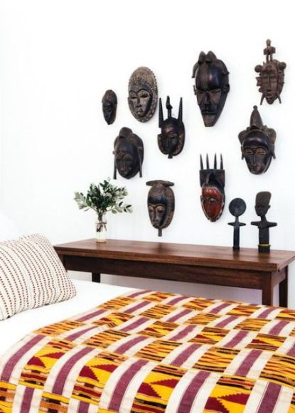 20-a-collection-of-african-carved-masks-on-a-bedroom-wall-for-a-statement