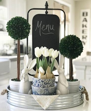 A-bucket-tray-with-greenery-topiaries-white-tulips-and-bunnies-for-a-farmhouse-spring-feel-in-the-kitchen