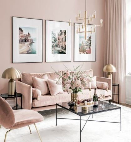 A-refined-living-room-with-blush-walls-blush-furniture-a-chic-gallery-wall-and-touches-of-gold-for-glam