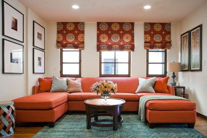 Rug-adds-subtle-pattern-to-the-living-room-with-bold-orange-couch