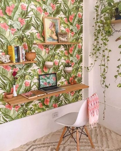 A-colorful-tropical-home-office-nook-with-a-tropical-accent-wall-a-floating-desk-and-shelves-and-potted-plants
