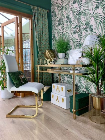 A-glam-and-chic-tropical-home-office-with-a-pink-printed-wall-green-walls-curtains-and-accessories-plus-much-gold
