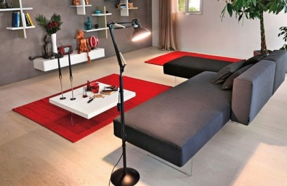 Contemporary-gray-sofa-red-area-rugs-white-wall-shelves-cofee-table