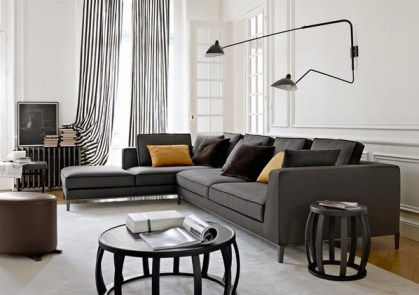Modern-living-room-furniture-gray-sofa-round-coffee-table-side-table-black-white-curtains