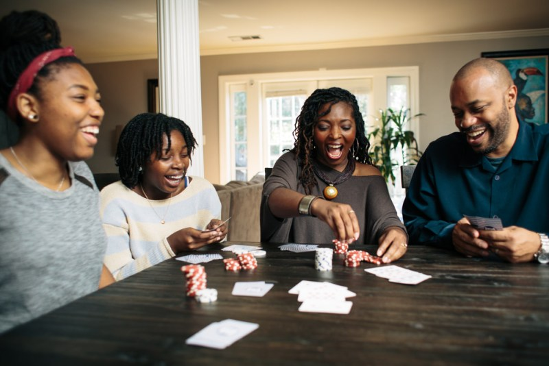 The Millner family playing poker and laughing