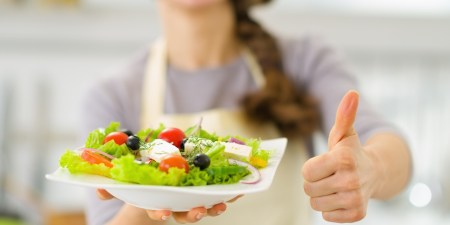 Closeup on woman showing fresh salad and thumbs up; Shutterstock ID 135242864; PO: aol; Job: production; Client: drone