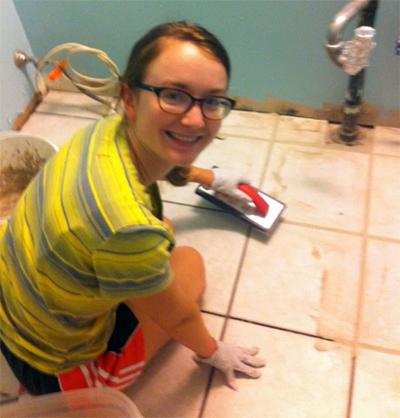Samantha tiling her bathroom.