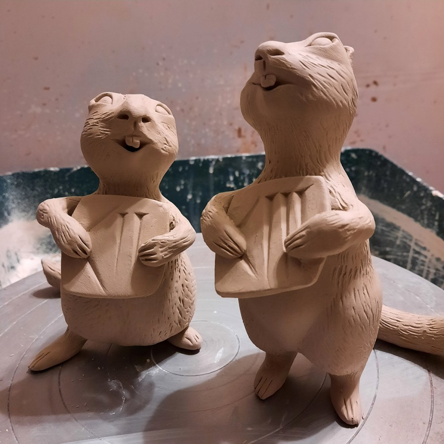 Clay chipmunks with Babylonian numbers by Liz Paley