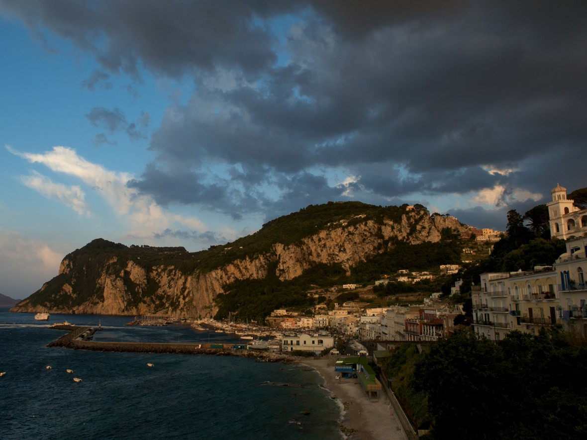 dark clouds gather above the harbour in the town of Capri, Italy