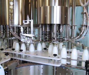 Figure 1: Machine Filling Milk Bottles. (Source)