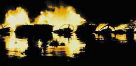 Figure M: PT boat burning in the Philippines.