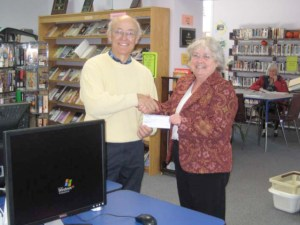 Jerry Behnke with Blind River Librarian Rhea Marcellus