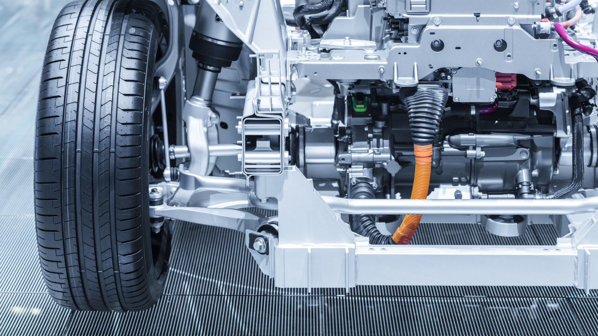 EV battery Chassis of the electric, hybrid car with powertrain. Blue toned.