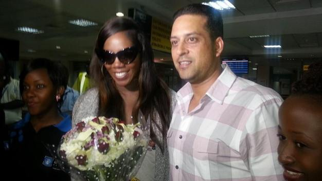 Tiwa with Talent Africa's Aly Alibhai at Entebbe Airport.