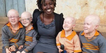 Uwitware is known for her compelling everyday people stories. In the photo she was with albino school children.
