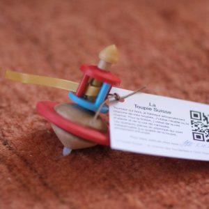 toupie-zen-manege-rouge-et-bleue-tourne-5-minutes-matoupie-jean-pierre-de-siebenthal-artisan-local-faiseur-de-toupies-fabrication-suisse