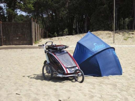 Strandmuschel und Kinderwagen