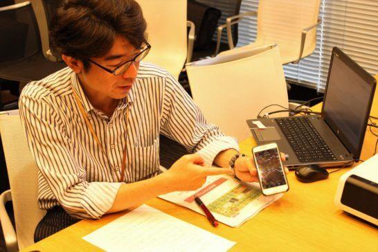 岡三オンライン証券の鈴木さんのスマホアプリの説明