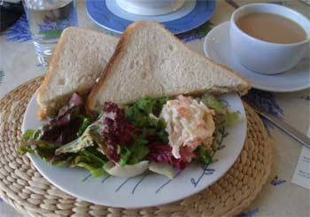 Coronation chicken sandwich on white bread