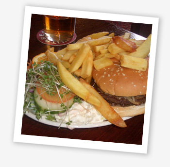 Succulent beefburger served in a sesame seed bun with fried onions, side salad and a portion of chips