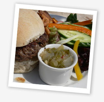 8oz Kings Manor Gourmet Burger served in a floured, Island bap with hand cooked crisps and salad